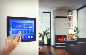 Mounted digital thermostat controlling the heating and cooling of individual rooms in a home