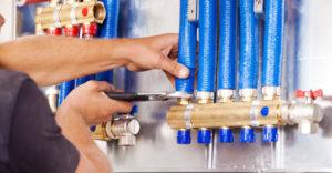 furnace technician repairing pipes