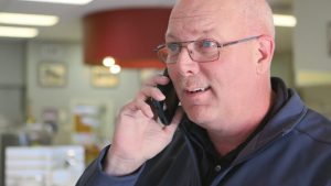 Standard Plumbing, Heating & Air plumber on phone answering water heater questions