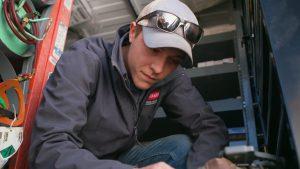 HVAC tech Dalton in repair truck at home in Manhattan, Kansas