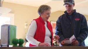 Standard Plumbing, Heating & Air technician going over maintenance program with a woman in her Manhattan, Kansas home