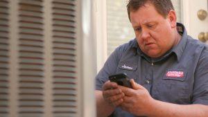 Standard AC technician repairing an air conditioner in Manhattan area