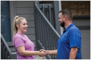 plumber shaking hands with home owner