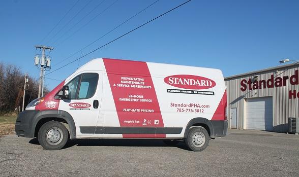 Photo of Standard Heating & Air service van outside Manhattan shop