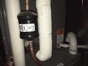AC drain line for refrigerant