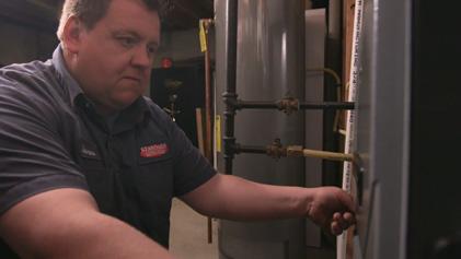 Furnace in basement getting serviced by Standard Heating & Air in Manhattan, KS