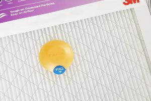 Yellow sensor device on Smart Air Filters that send information to an app on when your dirty filter needs to be changed