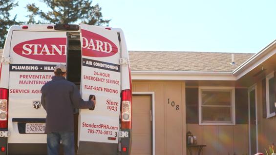 Standard Heating furnace installer unloading van at Manhattan, KS home