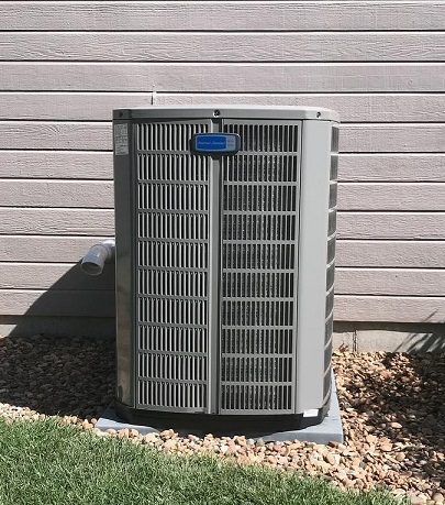 outside air conditioning condenser unit serviced by Standard in Manhattan, KS